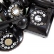 A group of vintage telephones on a white background — Stock Photo