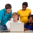 Diverse group of college students or friends looking at a computer — Stock Photo
