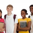 Stock Photo: Multi-ethnic college students/friends with backpacks and books o