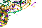 A Mardi gras mask and beads on a white background with copy spac — Stock Photo