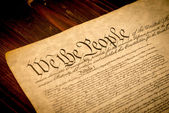 The United States Constitution on a wooden desk — Stock Photo