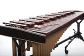 A brown wooden marimba on a white background — Stock Photo