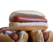 A stack of hotdogs and buns on a white background — Stock Photo