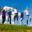 A group of diverse college students, friends jumping in the air — Stock Photo