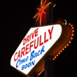 Famous Leaving Las Vegas sign at night — Stock Photo #25495501