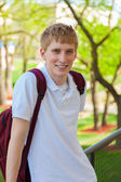 Young, smiling college male student outside — Stock Photo