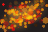 Bokeh background with reds and yellows — Stock Photo