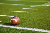 An American football on field — Stock Photo