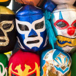 Arrangement of various luchador masks as a background — Stock Photo