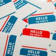 Stock Photo: Stack of name tags or badges