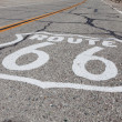 Route 66 highway shield painted on a old highway in California — Stock Photo