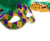 Marid Gras Mask and beads on white — Stock Photo