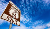 Historic Route 66 road sign on a blue sky — Stock Photo