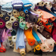Bolt or rolls of various colored fabric — Stockfoto