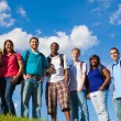 Stock Photo: Group of diverse students or friends outside