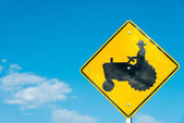 Tractor crossing sign with a sky blue background — Stock Photo