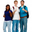 Three young college students showing the thumbs up sign — Stock Photo