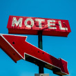 Vintage, neon, red hotel sign with a red arrow — Stock Photo