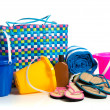 Beach bag with buckets, towel, flip-flops and suntan lotion — Stock Photo #35519349