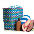 Beach bag with towel, flip-flops and suntan lotion — Stock Photo