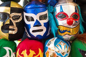 Arrangement of various luchador masks as a background — Foto Stock