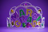 Mardi Gras crown on a purple background — Stock Photo