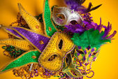 Colorful group of Mardi Gras or venetian mask or costumes on a y — Stock Photo