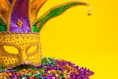 Colorful Mardi Gras or venetian mask or costume on a yellow background — Stock Photo
