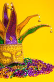 Colorful Mardi Gras or venetian mask or costumes on a yellow background — Stock Photo