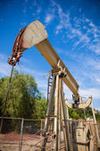 Horsehead pumpjack with a blue sky background — Stock Photo