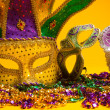 Colorful group of Mardi Gras or venetian mask or costumes on a y — Stock Photo #41178631