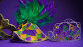 Assorted Mardi Gras or Carnivale mask on a purple background — Stock Photo