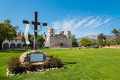 Mission Santa Barbara with cross and sky blue background — Stock Photo