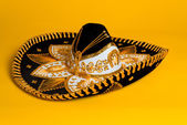 Ornate Gold, black and white Mexican sombrero — Stock Photo