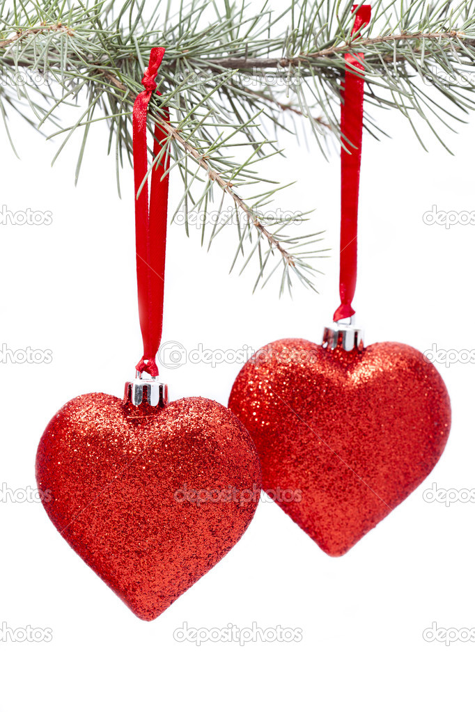 Christmas decorations hanging from the branch of a fir — Stock Photo #14249697