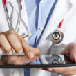 Stock Photo: Doctor with tablet