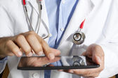 Doctor with tablet — Stock Photo