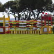 Obstacles in jumps race - Stock Photo