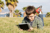 Boy with a laptop — Stock Photo