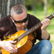 Guitarist in the street — Stock Photo #44628677