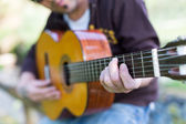 Guitarist in the street — Stock Photo