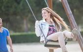 Man swinging his girl — Stock Photo