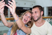 Young couple getting a photo — Stock Photo