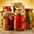 Composition with jars of pickled vegetables. Marinated food - Stock fotografie