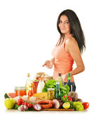 Young woman with variety of grocery products — Stock Photo
