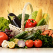 Fruits and vegetables in wicker basket — Stock Photo