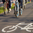 Bicycle road sign on asphalt — Stock Photo #13855004