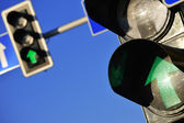 Traffic lights over a blue sky — Stock Photo