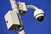 Hi-tech dome type camera over a blue sky — Stock Photo