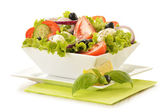 Composition with vegetable salad bowl — Stock Photo